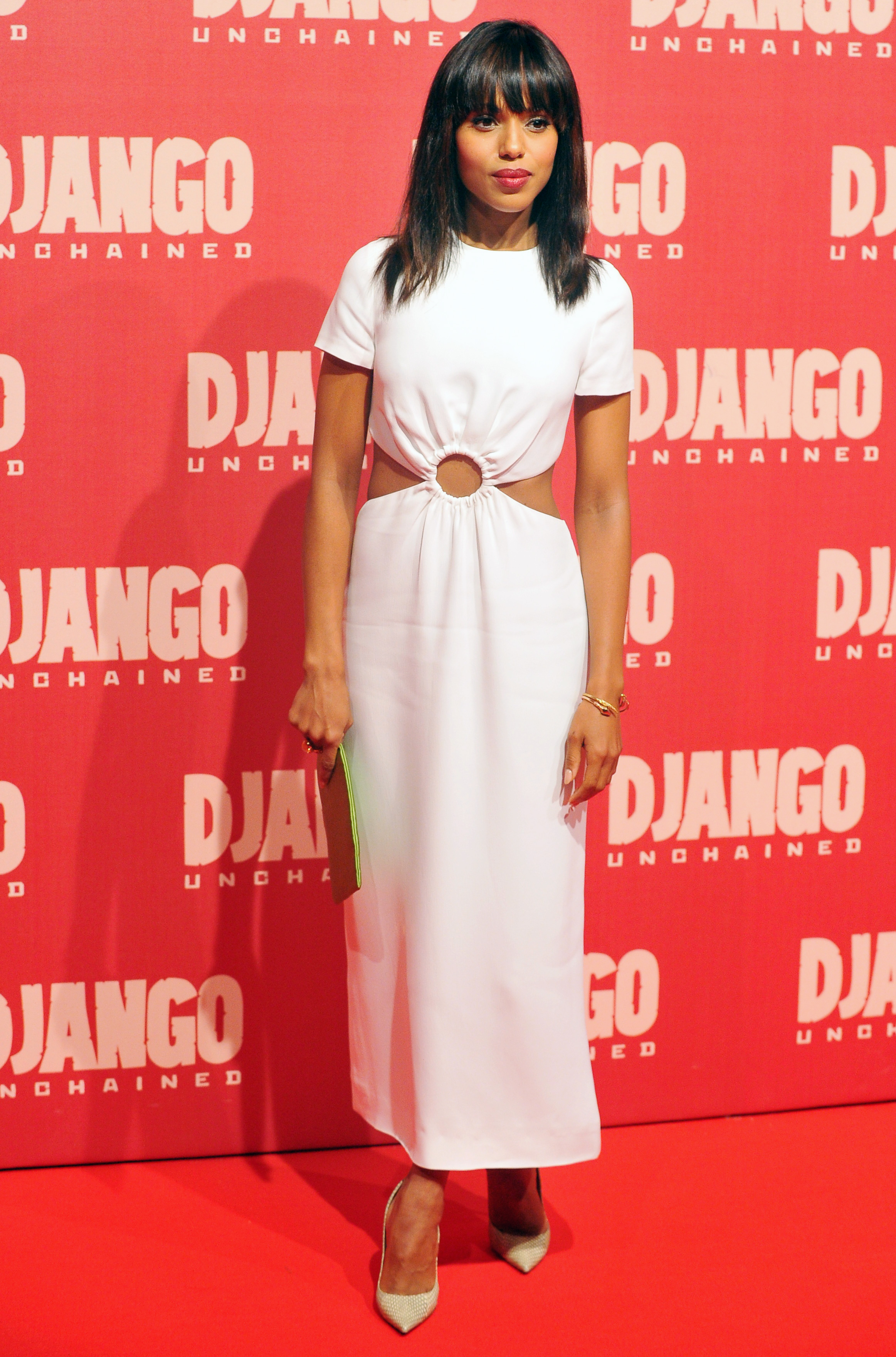 Kerry stepped out in a Winter white cutout Prada dress for the film's premiere in Rome, being sure to keep the look ultrafeminine with pointed-toe pumps, a sleek hairdo, and a sweep of red lipstick. She also added a slim green clutch and Ippolita cocktail ring.