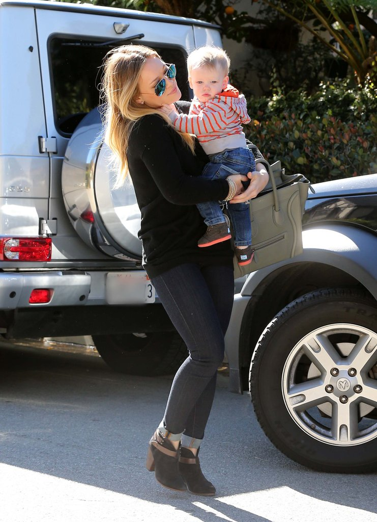 Hilary Duff carried little Luca Comrie in Beverly Hills.