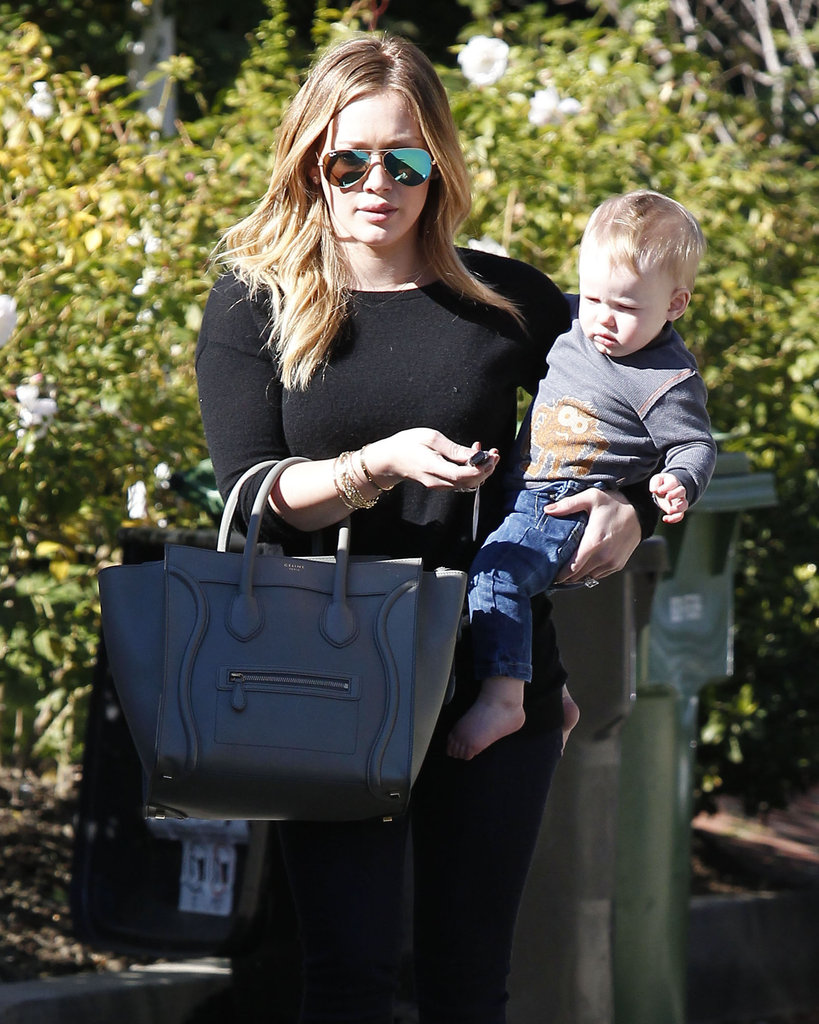 Hilary Duff carried her purse and little Luca Comrie.