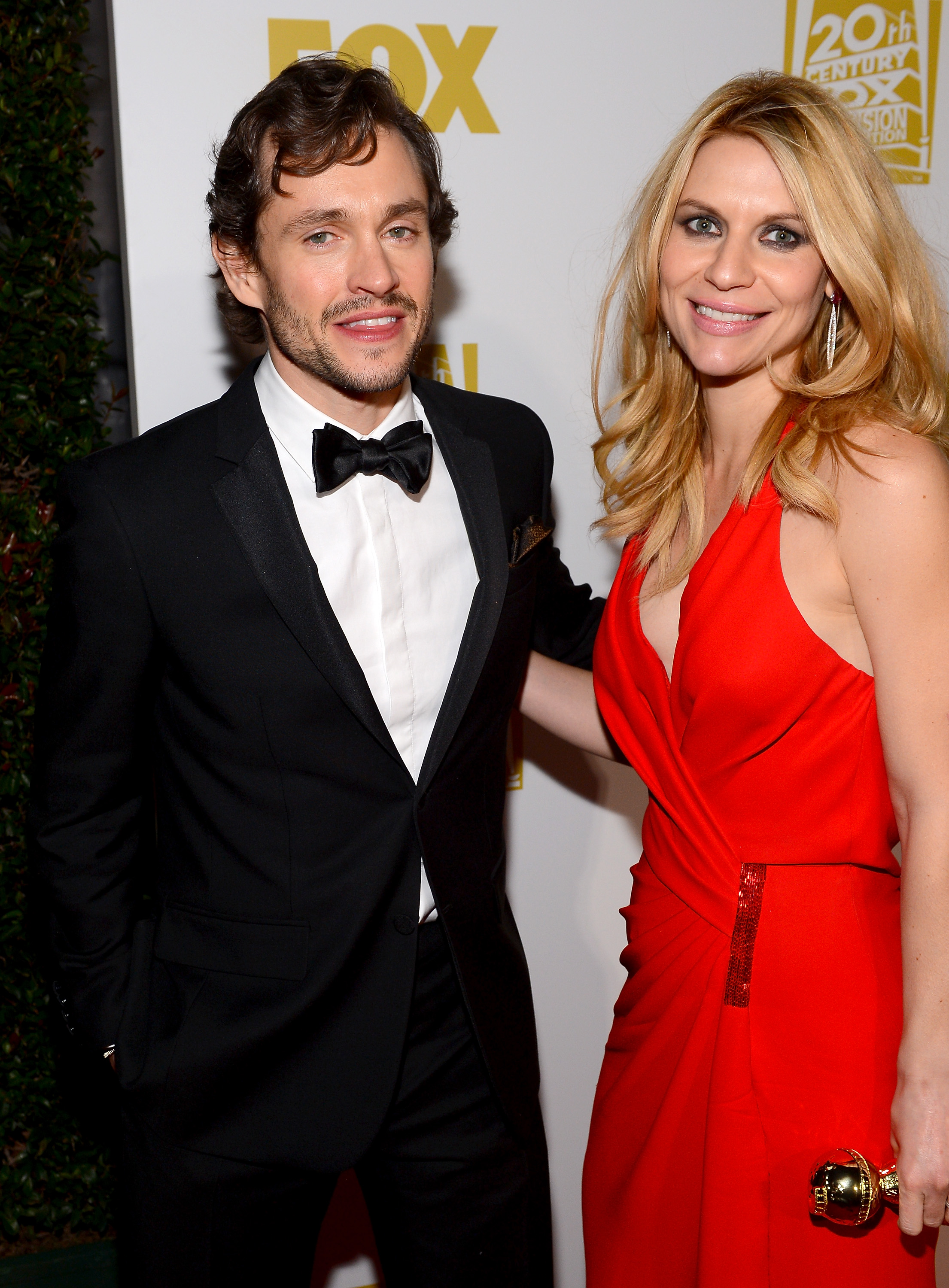 Couple Claire Danes and Hugh Dancy posed with her Golden Globe.