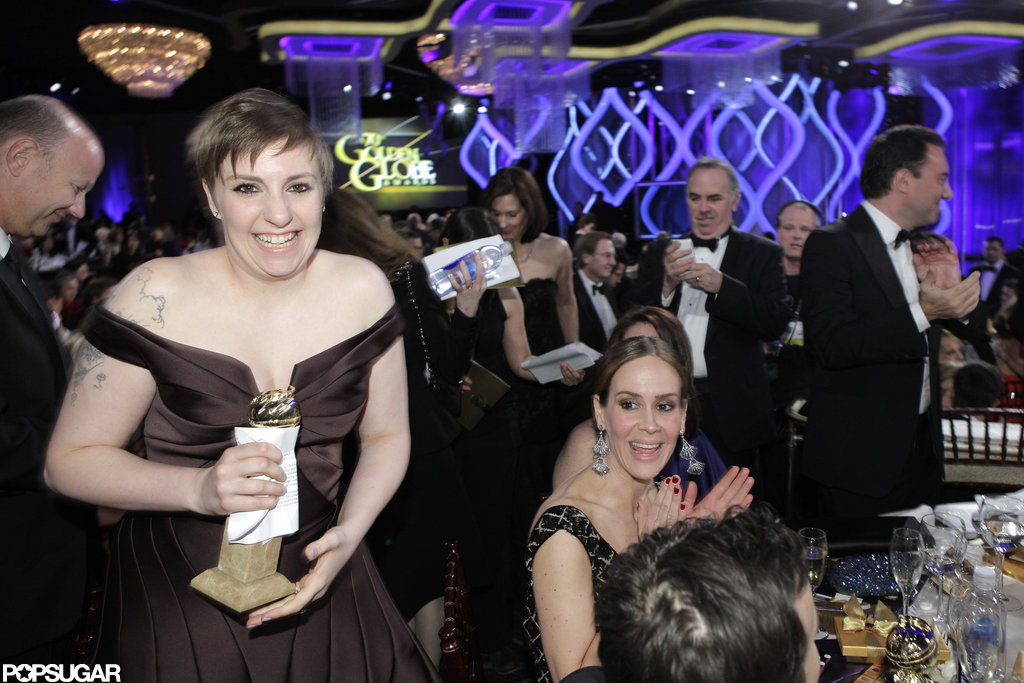 Lena Dunham smiled big after picking up her Golden Globe statue for Girls.