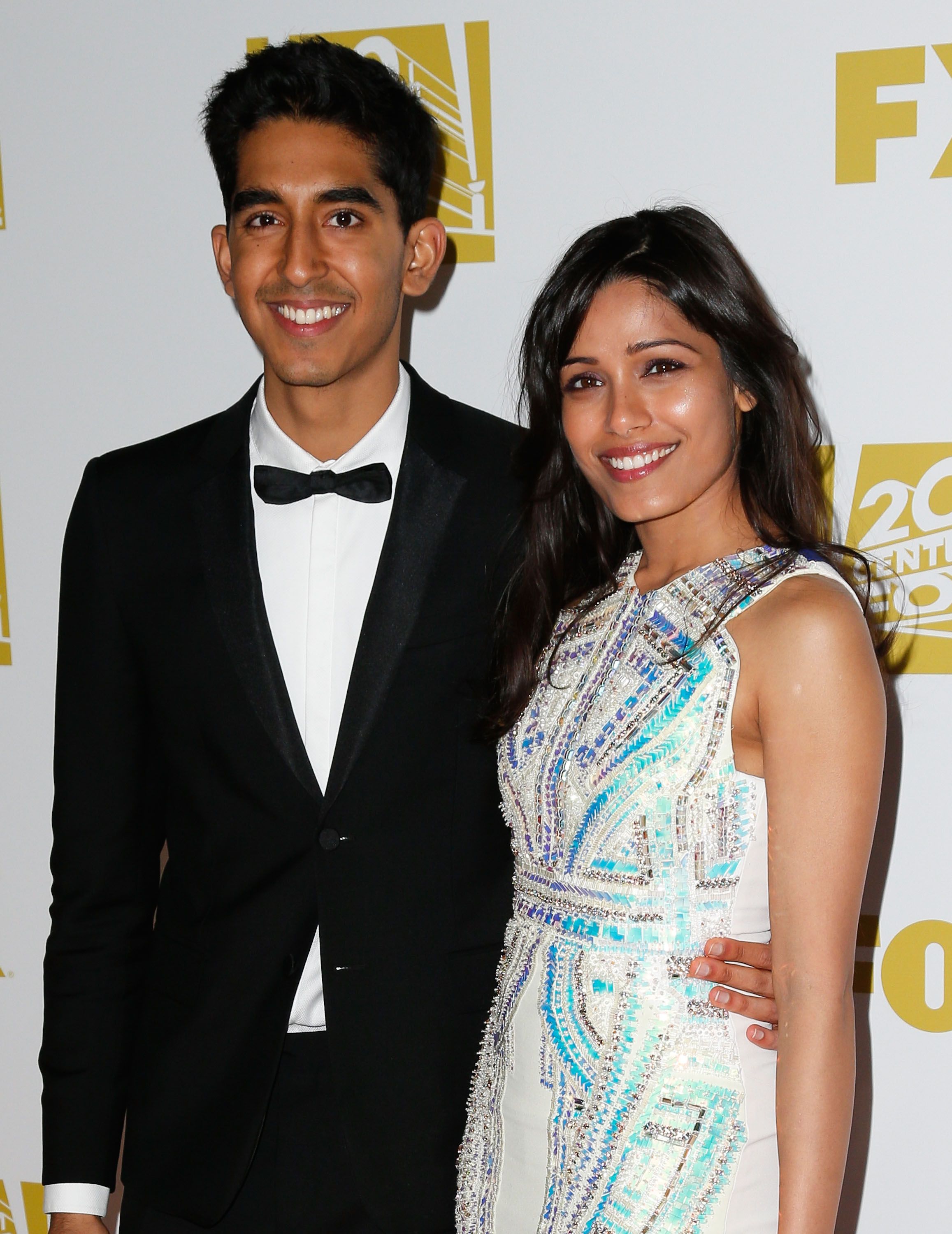 Dev Patel and Freida Pinto smiled for cameras at the Fox Searchlight after party.
