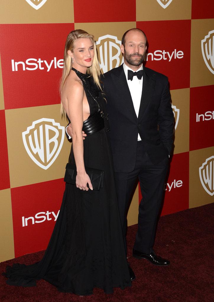 Rosie Huntington-Whiteley and Jason Statham smiled for photos.
