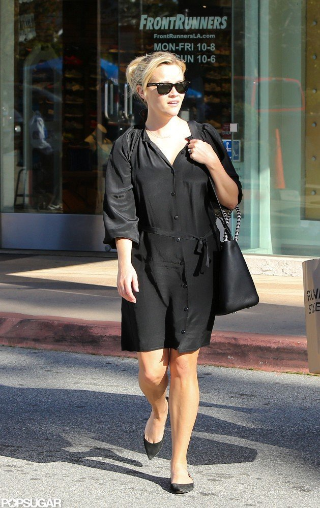 Reese Witherspoon wore a black dress and black flats.