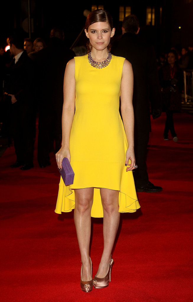 Kate Mara stood out in a yellow high-low dress and a Plukka amethyst necklace on the red carpet of the London premiere of Netflix House Of Cards. We especially appreciate the pop of purple thanks to her Nancy Gonzalez crocodile box clutch.