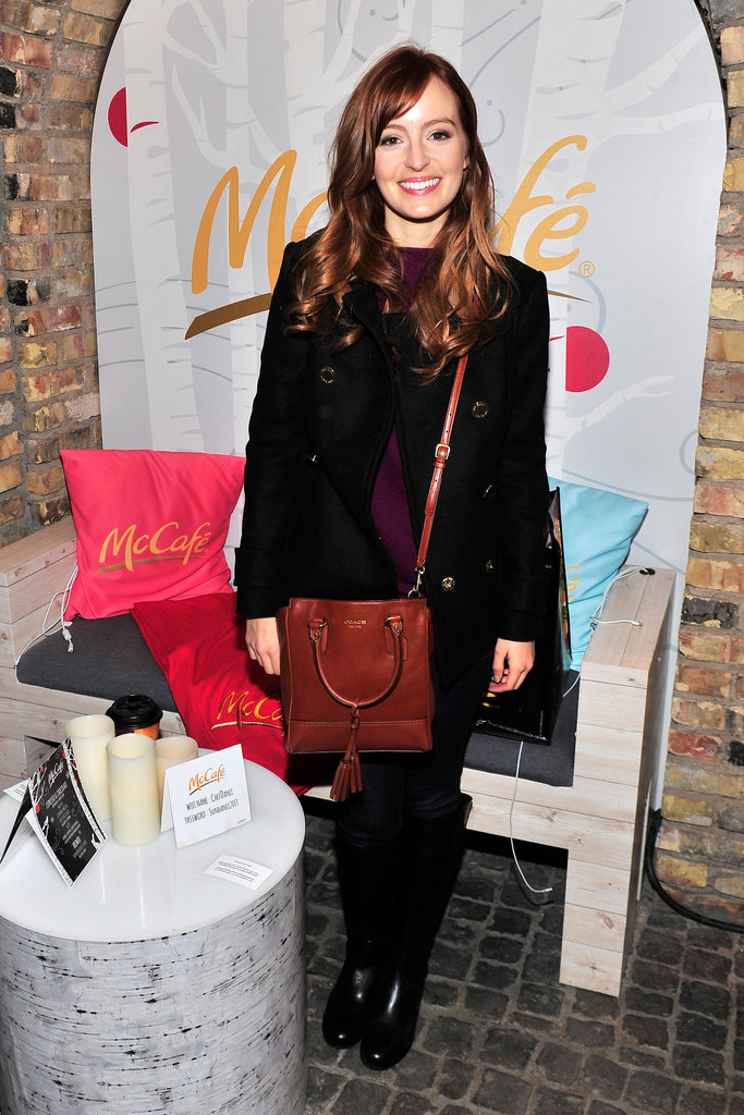 Ahna O'Reilly mixed neutrals with a whiskey-coloured Coach crossbody bag, Citizens of Humanity Avedon skinny jeans, a classic black peacoat, and matching leather boots, both by Tory Burch.