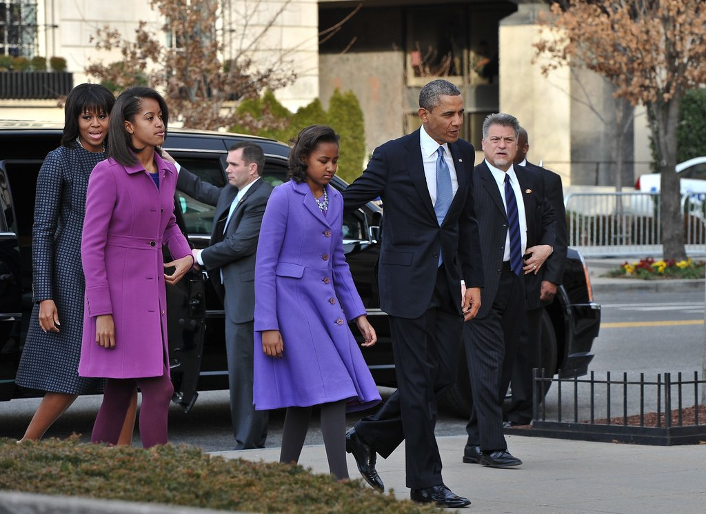 We love how Michelle's daughters, Malia and Sasha, showed off equally gorgeous plum-hued coats. Malia's fuchsia ensemble was by J.Crew, and Sasha's purple one by Kate Spade.