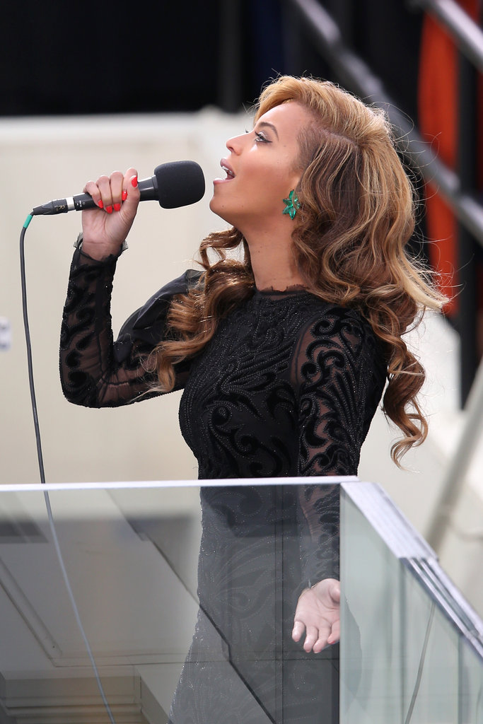 Beyoncé sang the national anthem in serious style, accessorizing her Emilio Pucci gown with bold emerald Lorraine Schwartz earrings.