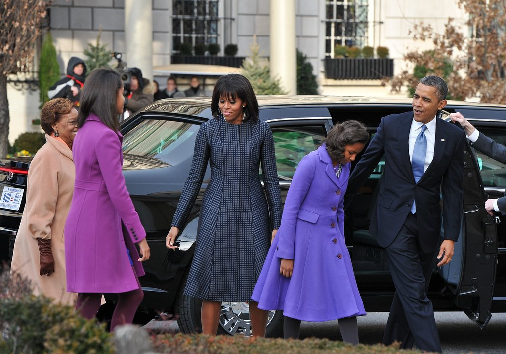 Michelle Obama arrived at St. John's Church this morning with her family wearing a navy Thom Browne coat paired with J.Crew pumps.