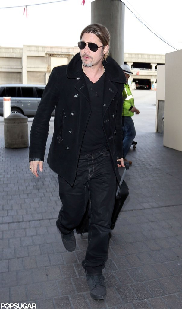 Brad Pitt wore his sunglasses as he arrived at LAX.