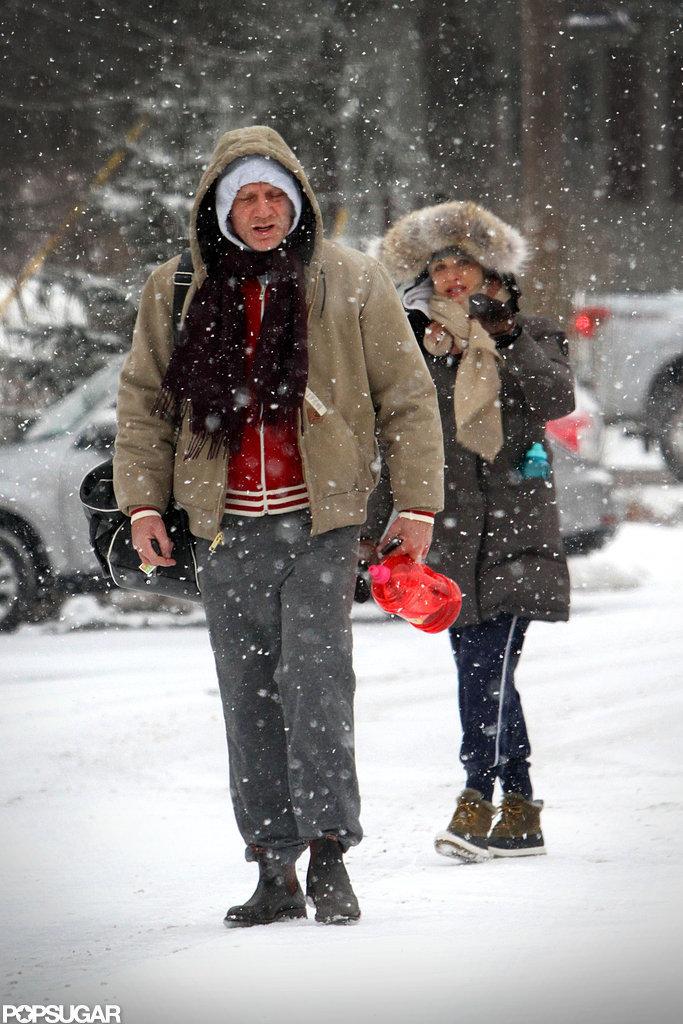 Daniel Craig wore sweatpants while Rachel Weisz bundled up in a parka.