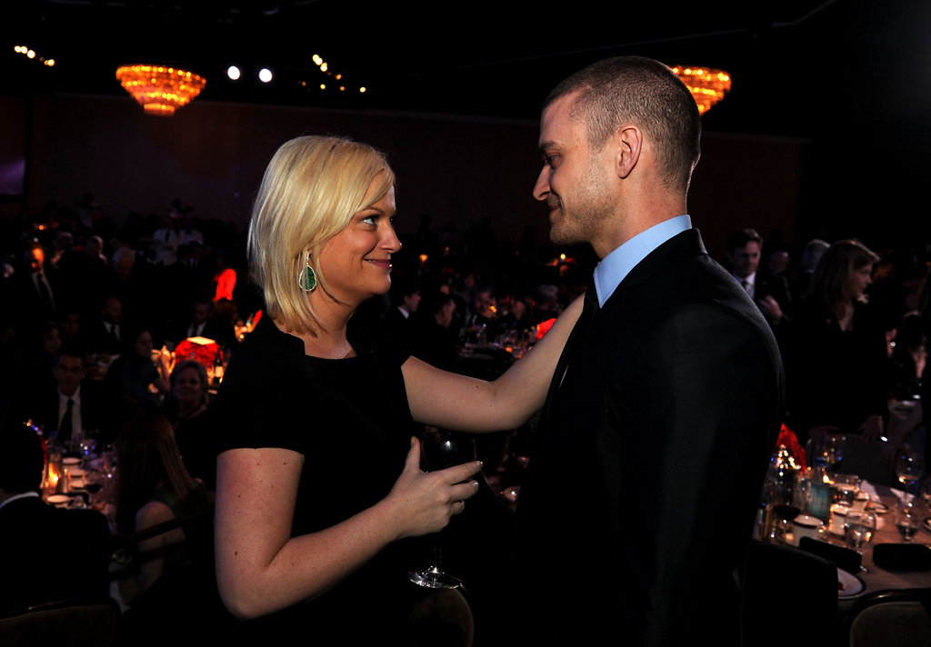 Amy Poehler and Justin Timberlake were deep in conversation at the Producers Guild Awards in January 2011.