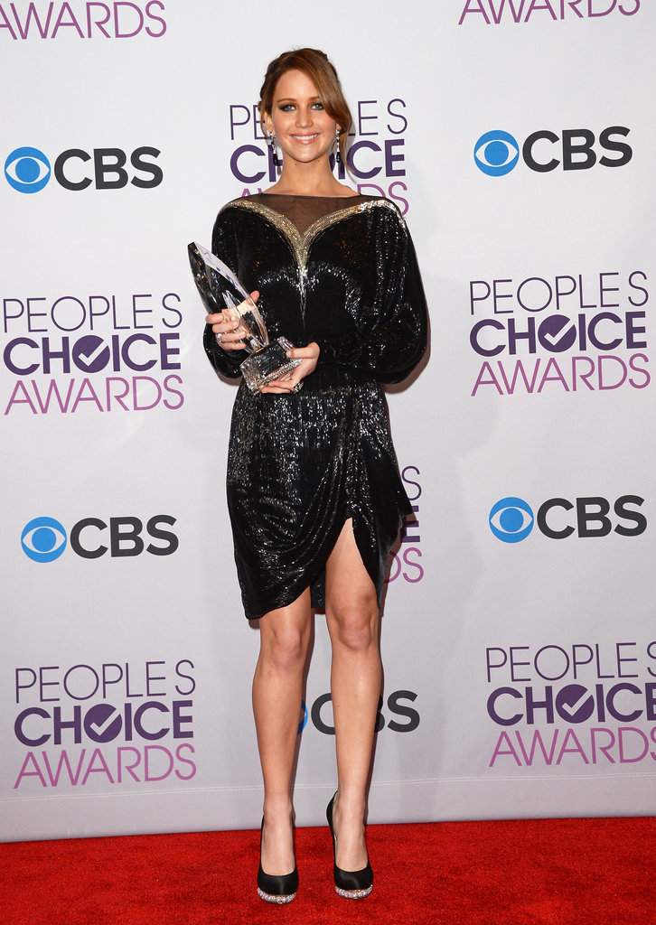 We can't tell which was more dazzling, Jennifer Lawrence's sequined Valentino Couture dress, her shiny award, or the Nicholas Kirkwood satin bejewelled platform pumps at the 2013 People's Choice Awards.