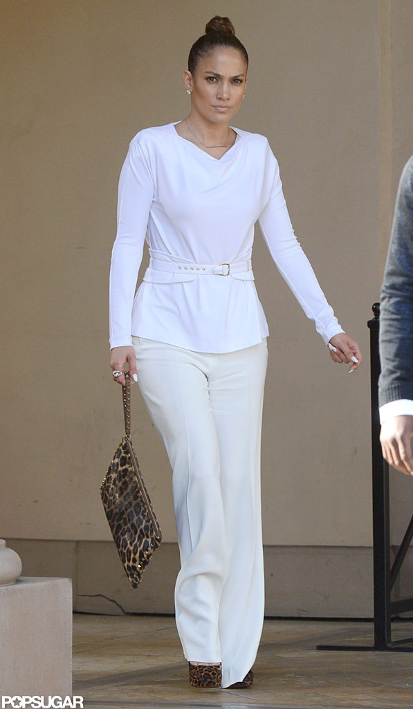 Jennifer Lopez paired a leopard clutch and heels with her all-white ensemble.
