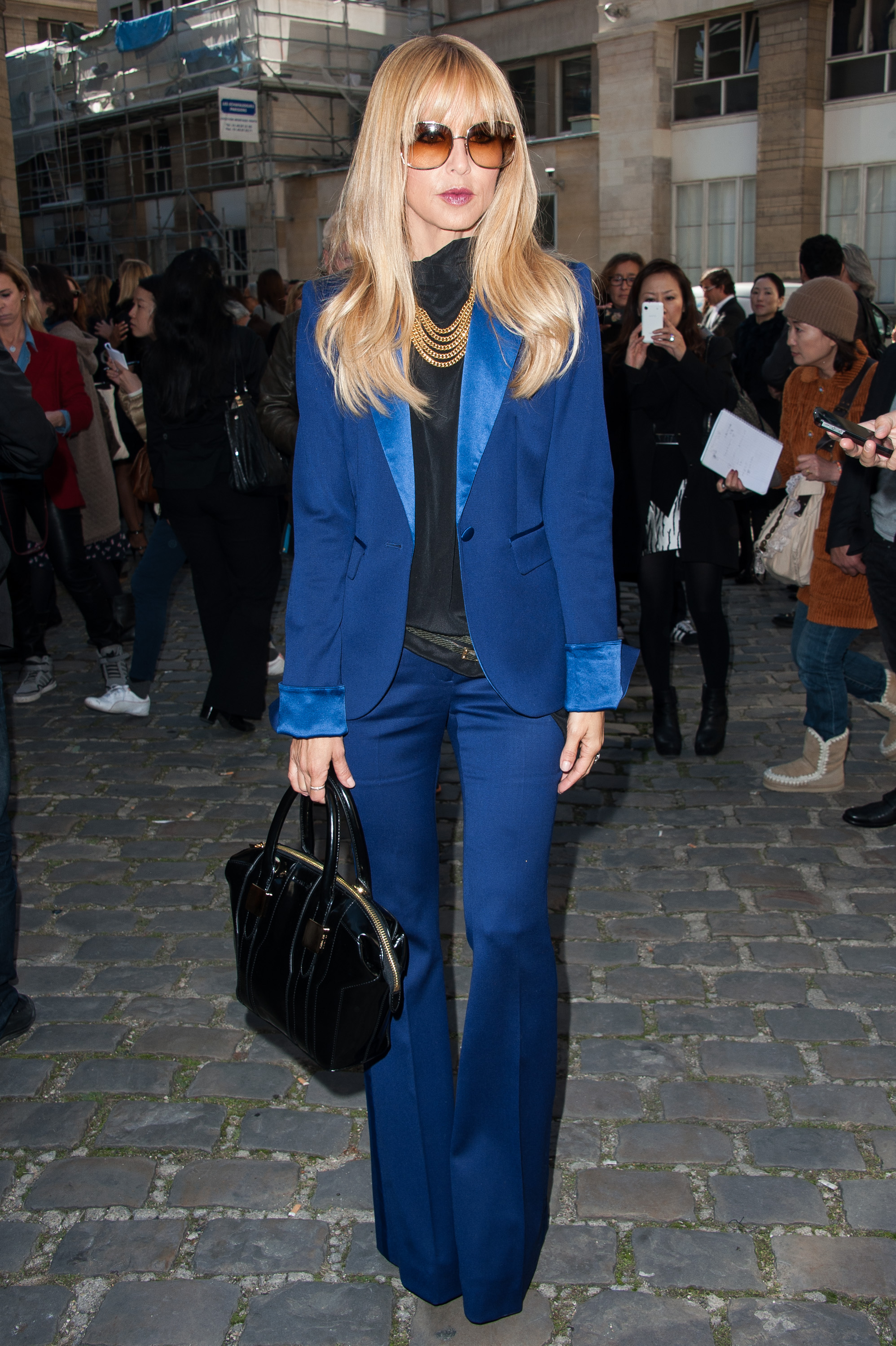 Rachel Zoe donned a cobalt-blue tuxedo-lapel pantsuit to Giambattista Valli's show in Paris, a real '70s-inspired treat.