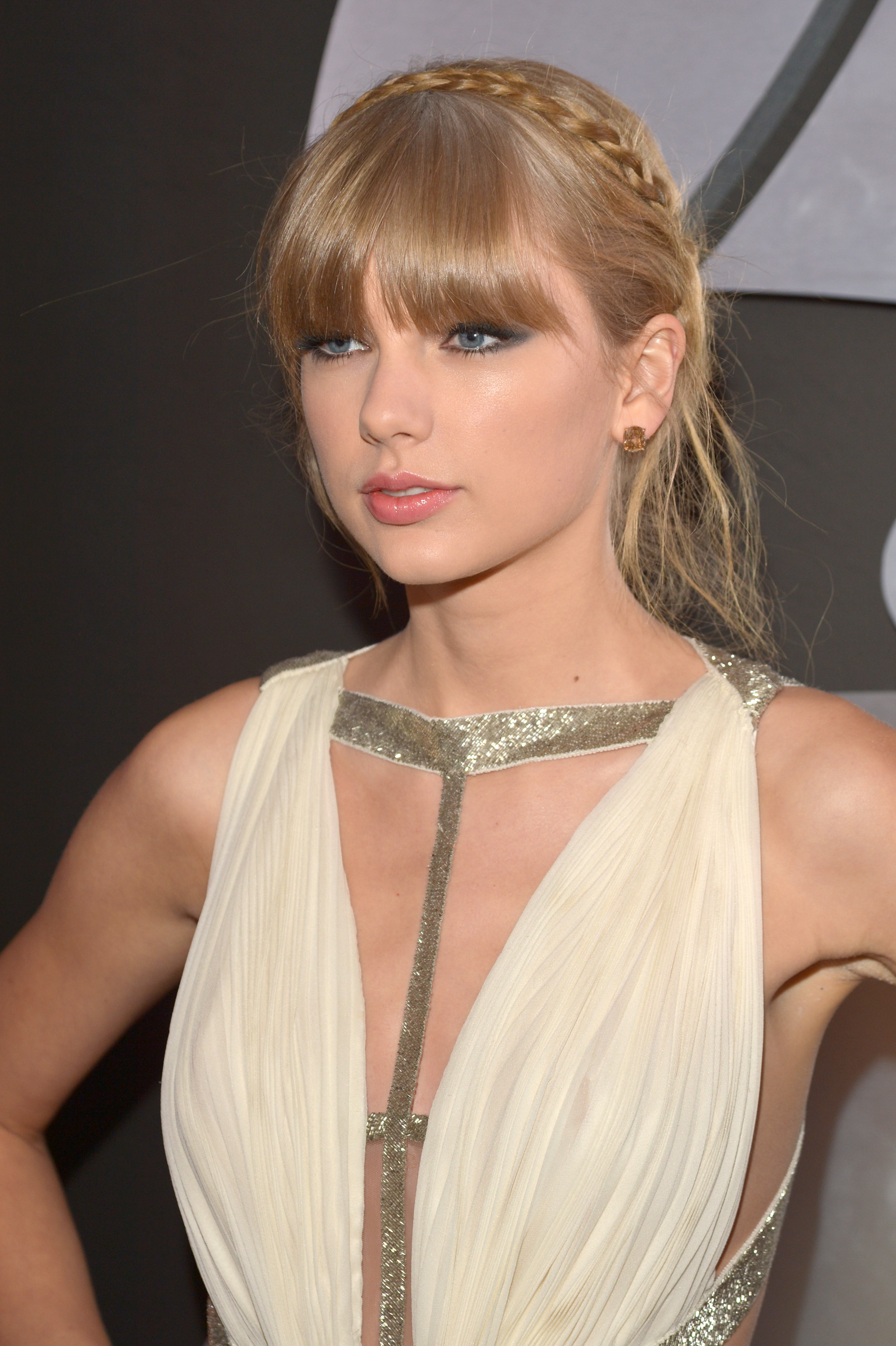 Taylor Swift wore a creamy J. Mendel gown to the Grammys.