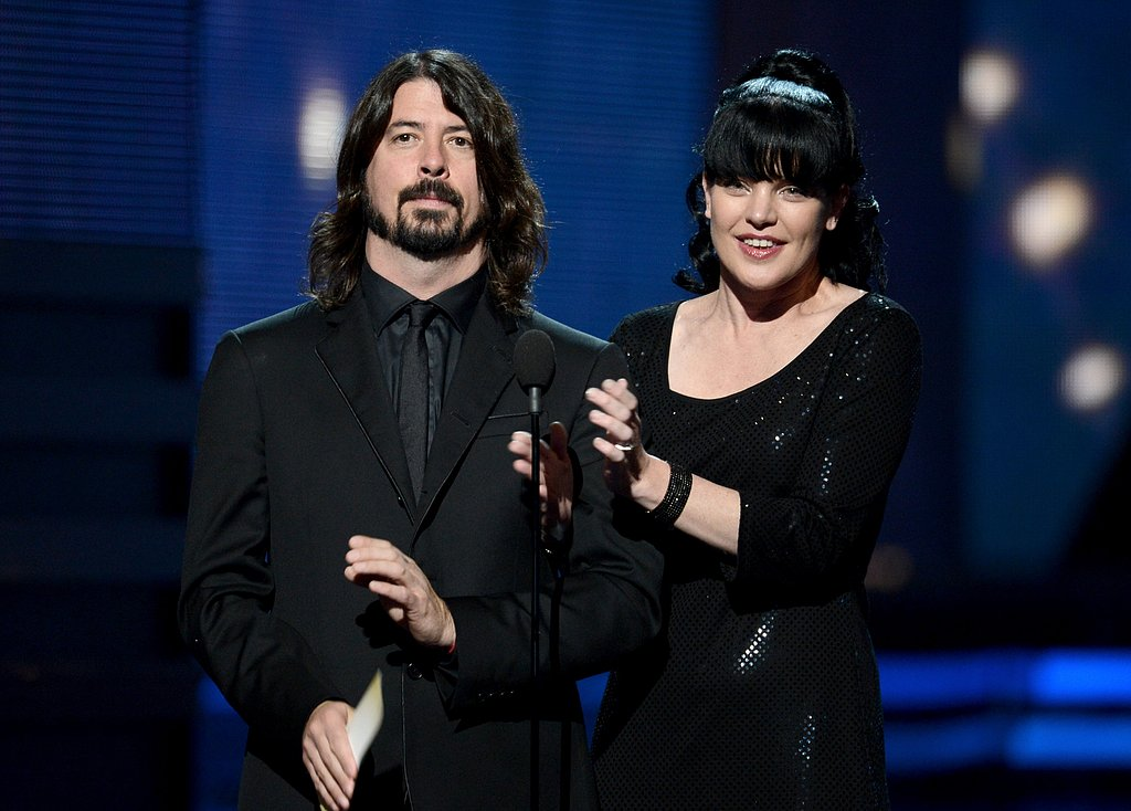 Dave Grohl presented with Pauley Perrette.