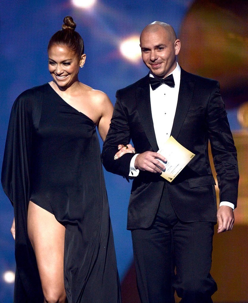 Jennifer Lopez and Pitbull stepped onto the stage together to present an award Sunday night.