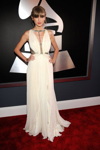 Taylor Swift struck a pose on the red carpet in her Grecian gown.
