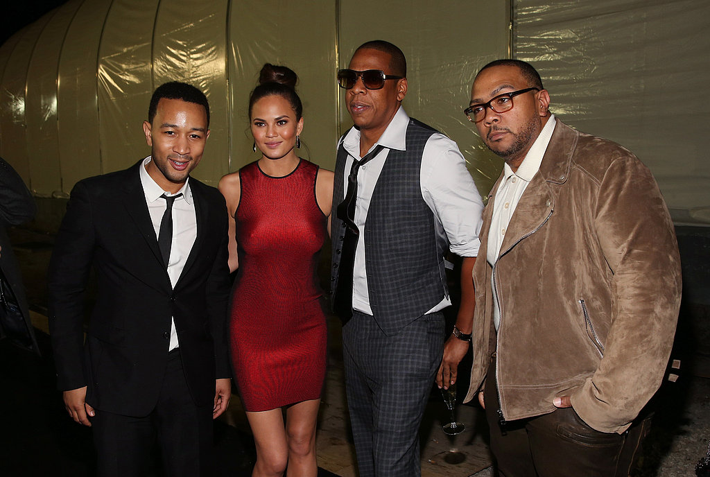 We caught sight of John Legend, Jay-Z, and Timbaland . . . with the always-gorgeous Chrissy Teigen in a skintight sporty red dress at the DirecTV Super Saturday Night party.