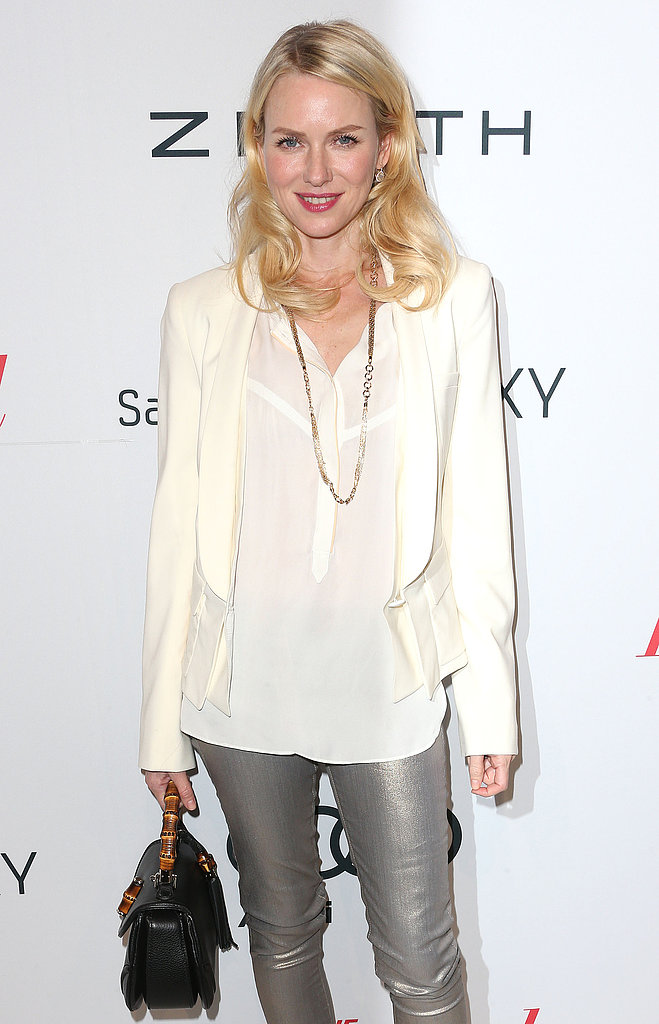 Naomi Watts paired her white blazer with gray pants.