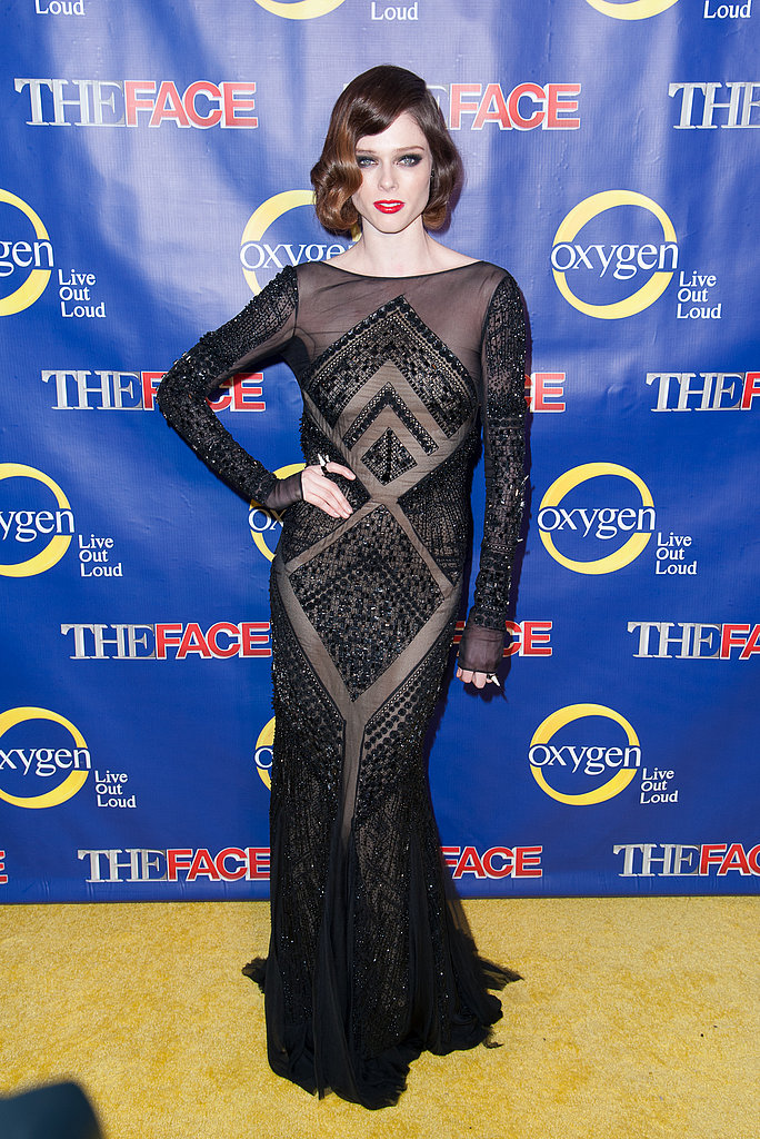 Coco Rocha donned a sexy, sheer Emilio Pucci gown, then furthered the vamp vibe with perfectly coiffed waves and a red pout.