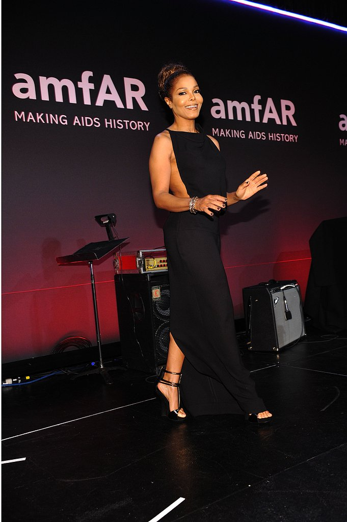 amfAR Honoree Janet Jackson took the stage in a sexy black gown with cutouts.