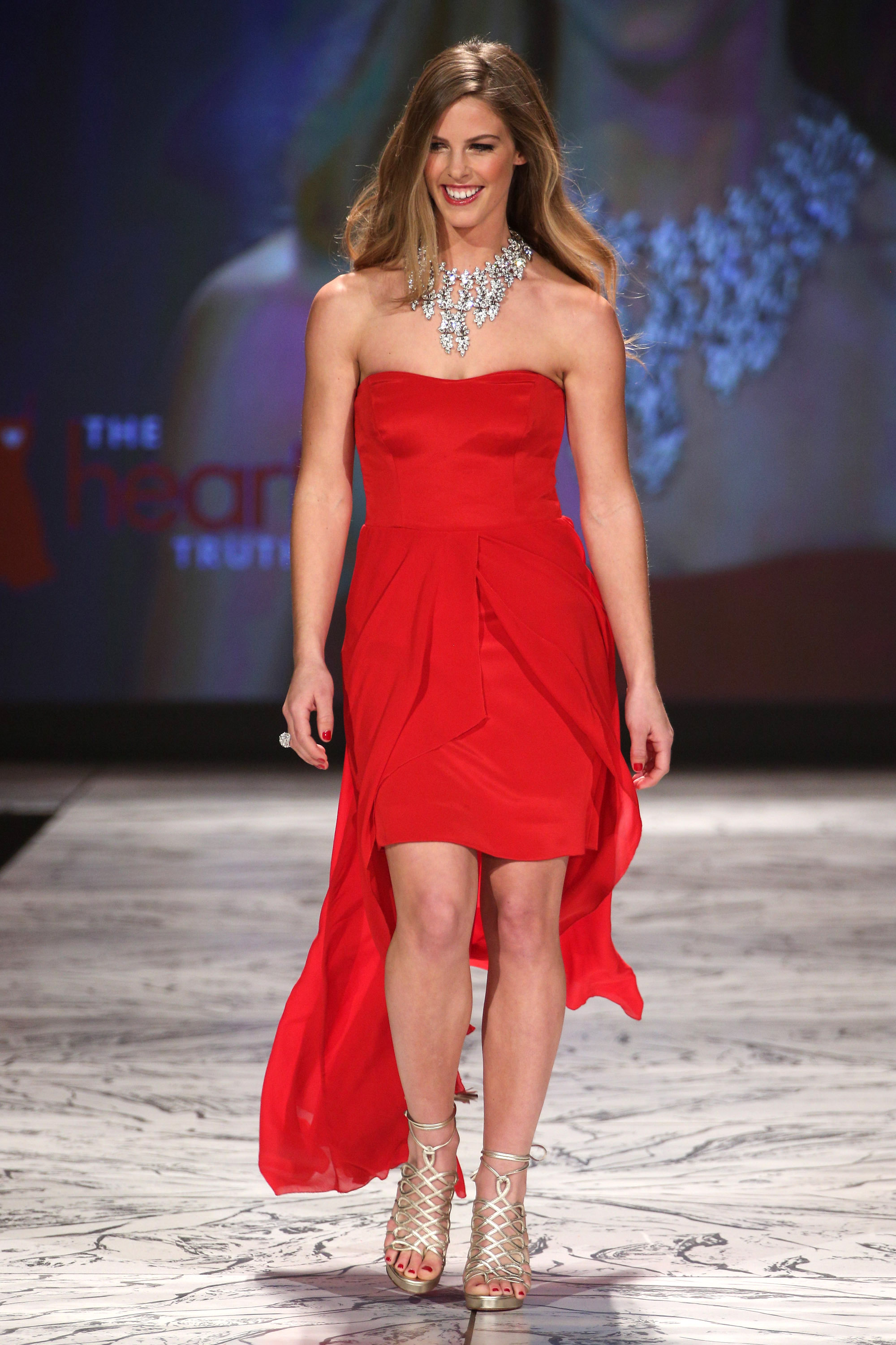 Torah Bright wore a strapless red gown by Nicole Miller ...