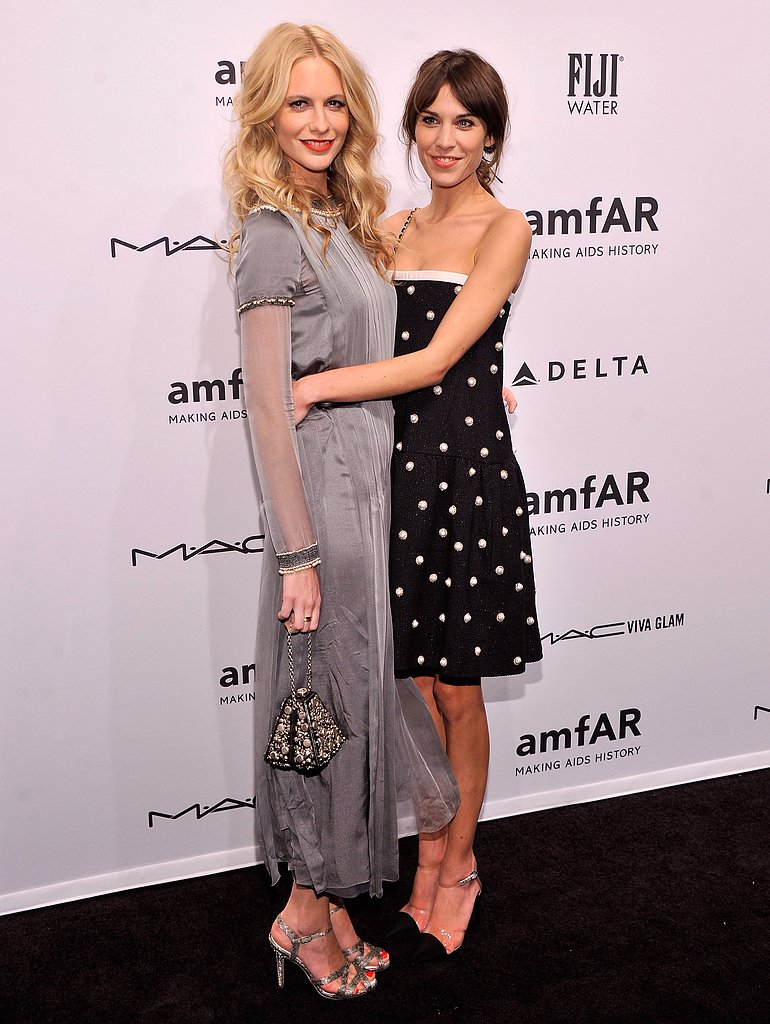 Alexa Chung hugged friend Poppy Delevingne at the amfAR New York Gala in February.