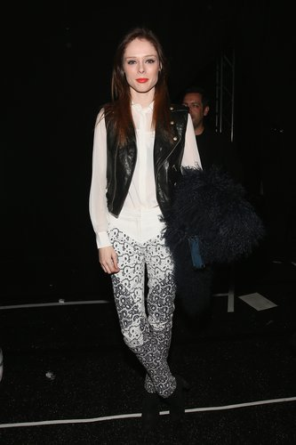 At Rebecca Minkoff, Coco Rocha sported printed jeans with a silky white blouse and a leather biker vest.
