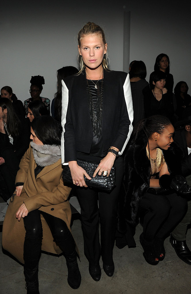 Alexandra Richards popped up at Helmut Lang's show wearing an on-trend black-and-white blazer with black pants and a crocodile clutch.