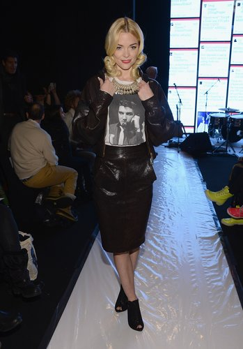 Jaime King popped her leather collar at Rebecca Minkoff. She completed her front-row style with an Elvis tee, a black leather pencil skirt, a dazzling bib necklace, and peep-toe booties.