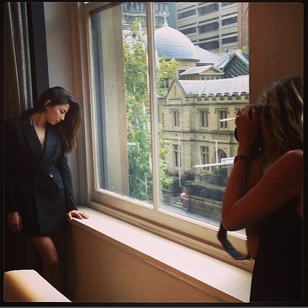 Stylist Romy Frydman shared this behind-the-scenes snap of Jessica Gomes working her magic for the camera. Source: Instagram user stylemeromy