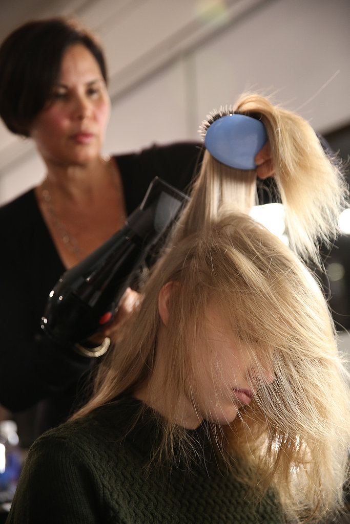 """To achieve the static effect, Gilbert blow-dried the hair upside down with Kérastase Mousse Substantive ($42) and a paddle brush by Mason Pearson. It's one technique that she even uses at home. """"If you dry your hair upside down then you get more volume because you lift your roots,"""" she said. """"I love it because I have baby hair."""""""