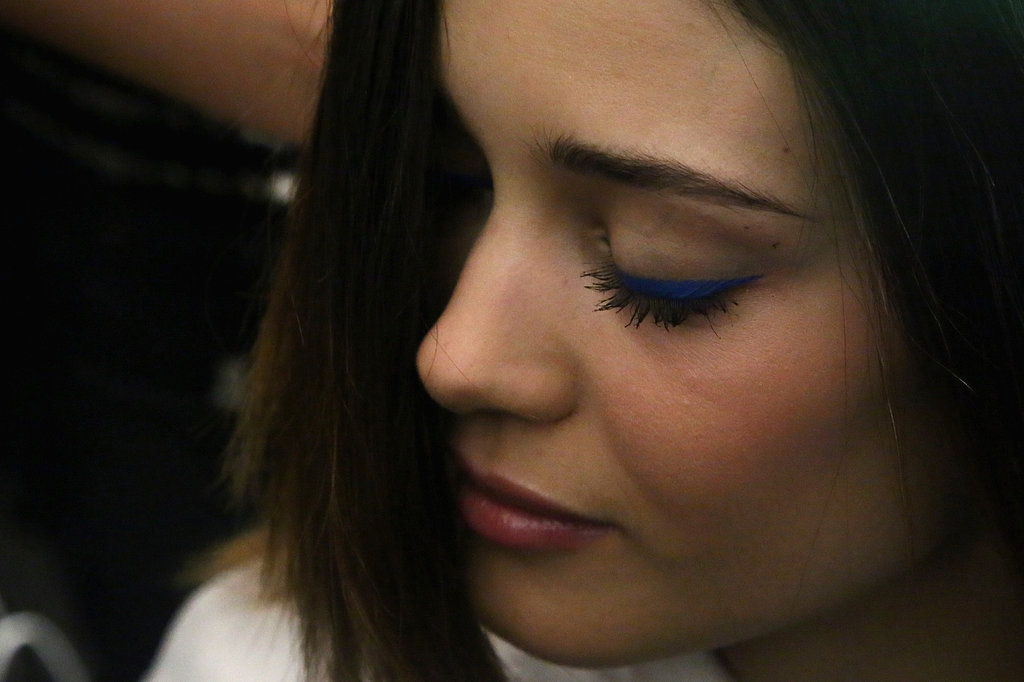 The liner was drawn on straight and went out slightly past the lash line to form a bold, structured look.