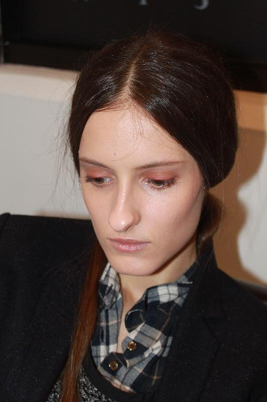 """For makeup, Carole Colombani used a palette of autumnal colors, comprising of beige, terracotta, and red. Skin was left clean, and the lashes were devoid of mascara. Even the lips were just brushed over with the excess product from the foundation brush . . . no color. The cheeks had a slight dewy contour created by mixing two neutral lipsticks. """"Makeup is freedom,"""" she said. """"It's really important for women to test and not be afraid of putting eye shadows on your mouth."""""""