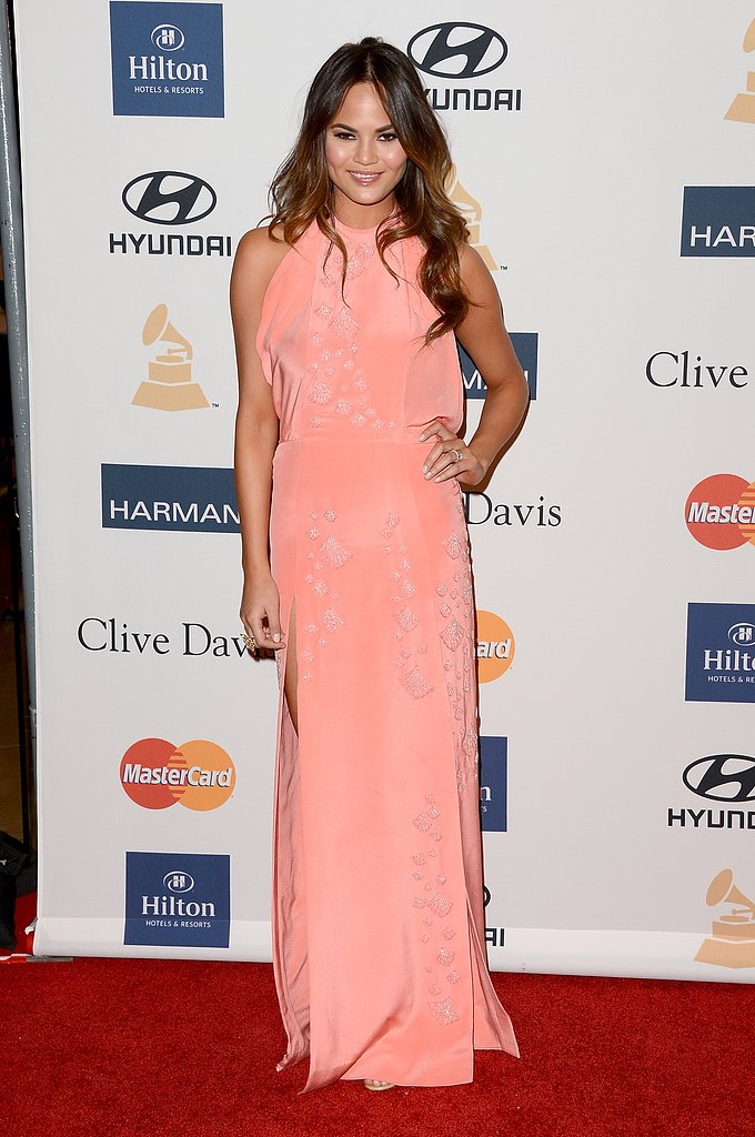 From her gorgeous sherbet-colored gown to her flawless beach waves, Chrissy Teigen's pre-Grammy style was sheer perfection.