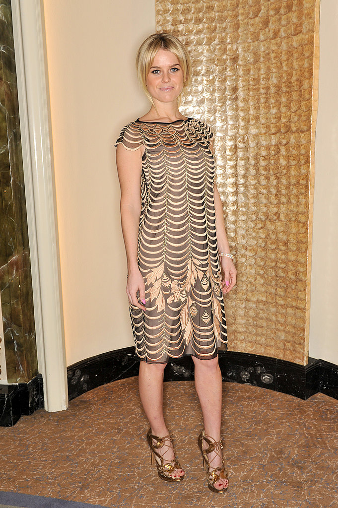 Alice Eve got glam for the Temperley London presentation, including a gold dress and matching gold sandals.