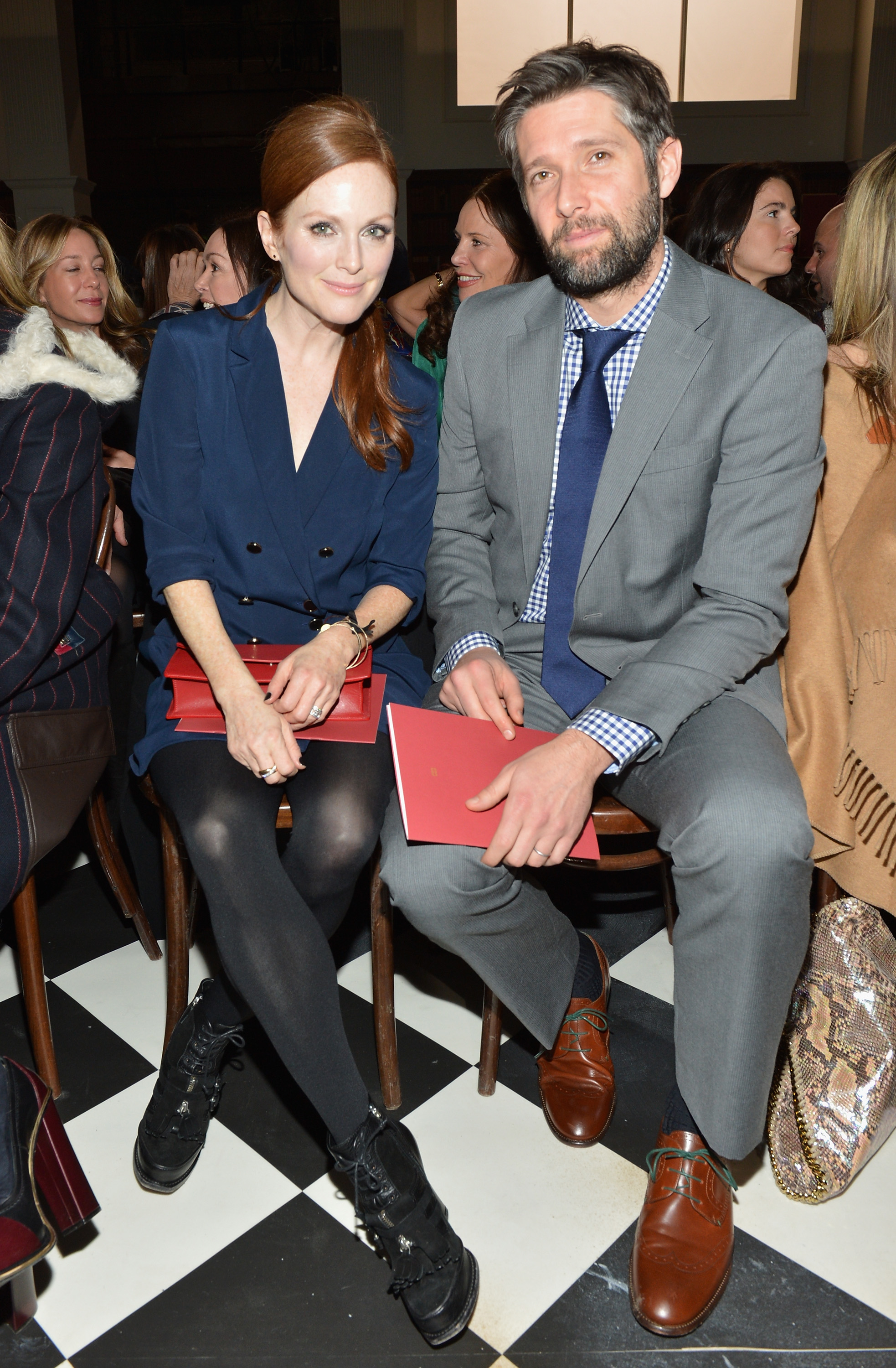 Julianne Moore sat next to Bart Freundlich at Tommy Hilfiger's women's collection fashion show on Saturday.