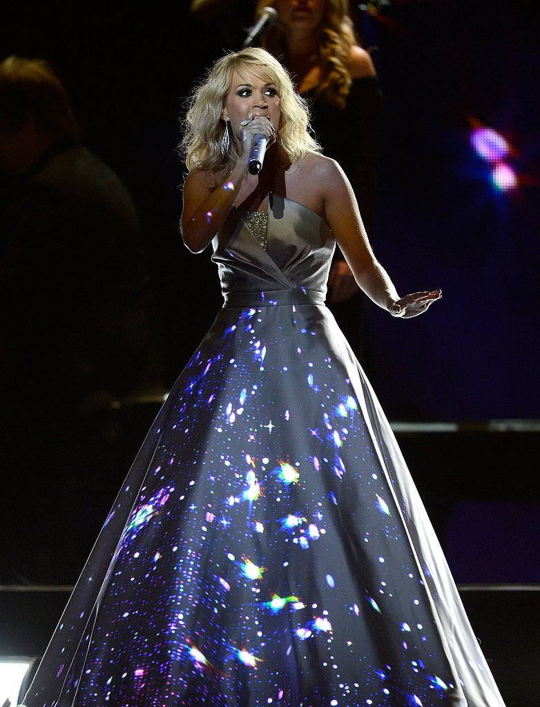 "Carrie Underwood's dress glowed with designs during her performance of ""Blown Away."""