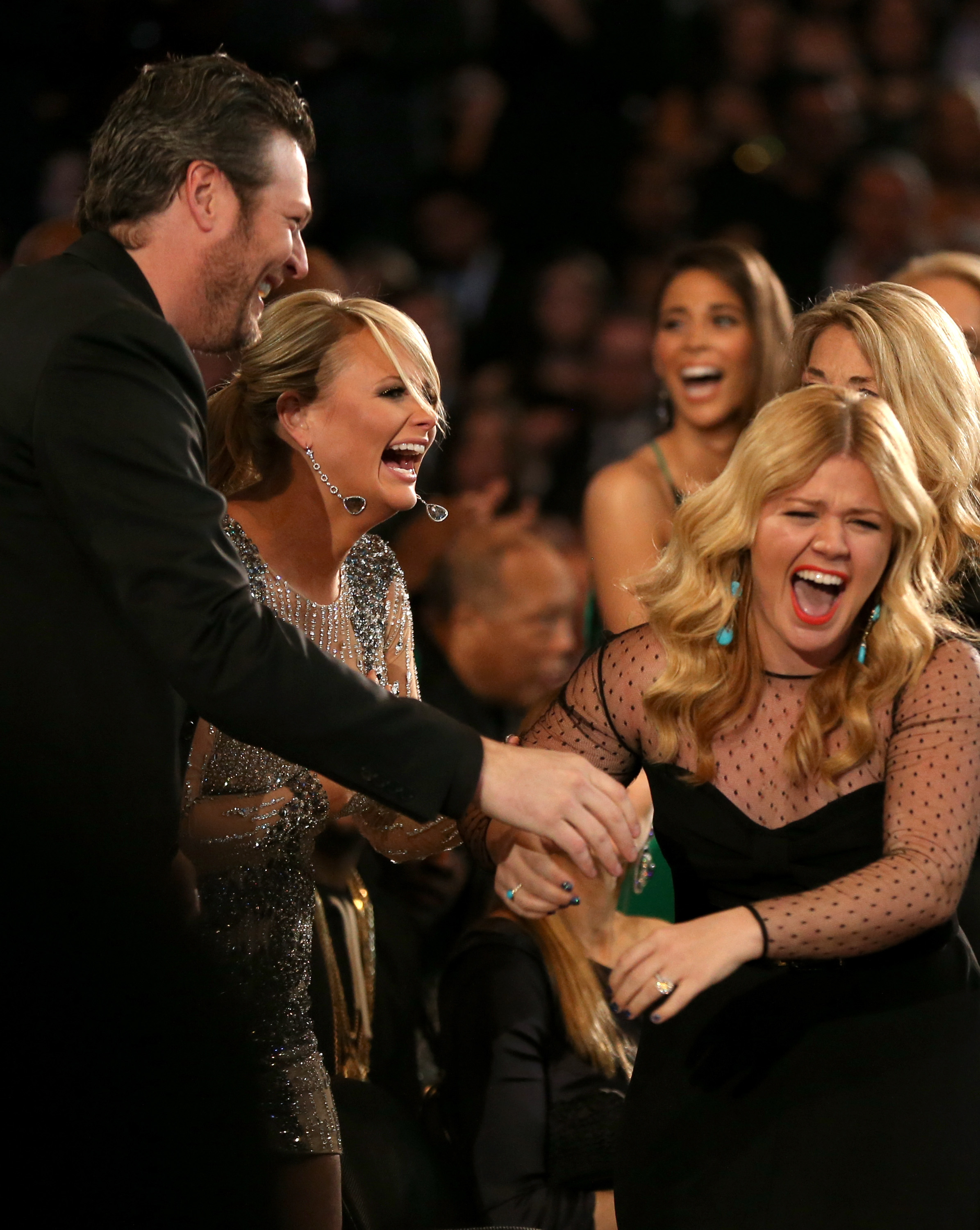 Miranda Lambert and Blake Shelton showed their excitement after Kelly Clarkson's big win Sunday night.