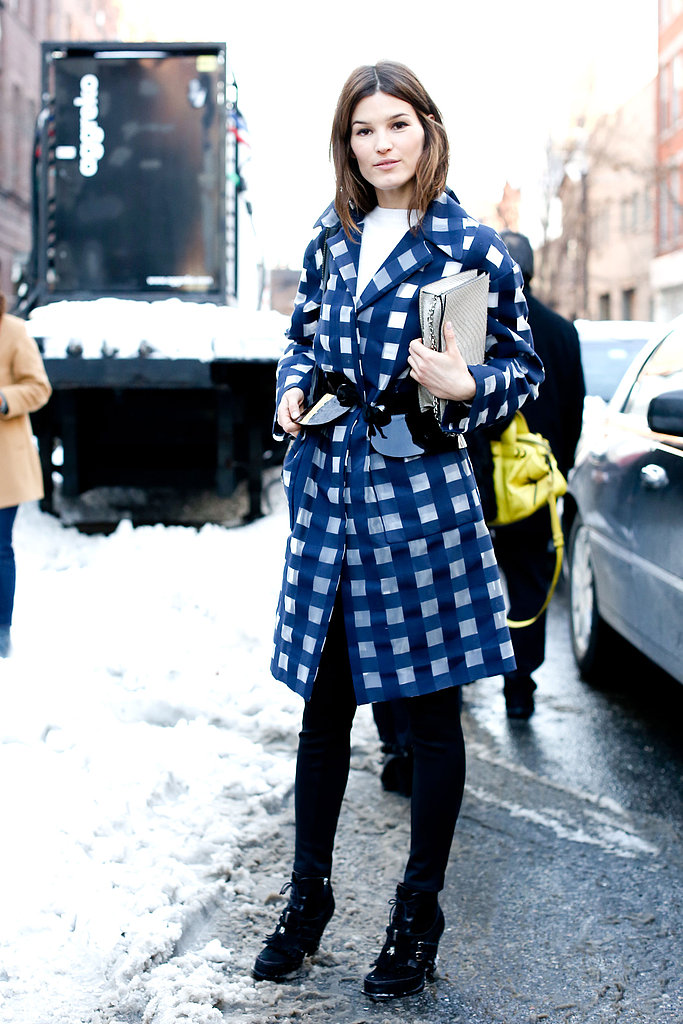 Hanneli Mustaparta made her outerwear count in an attention-grabbing checked coat.