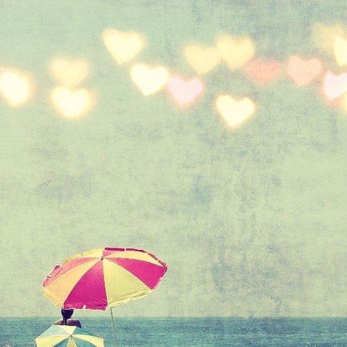 Heart-shaped bokeh details give this beach umbrella fine art photo ($30) a love-inspired twist.