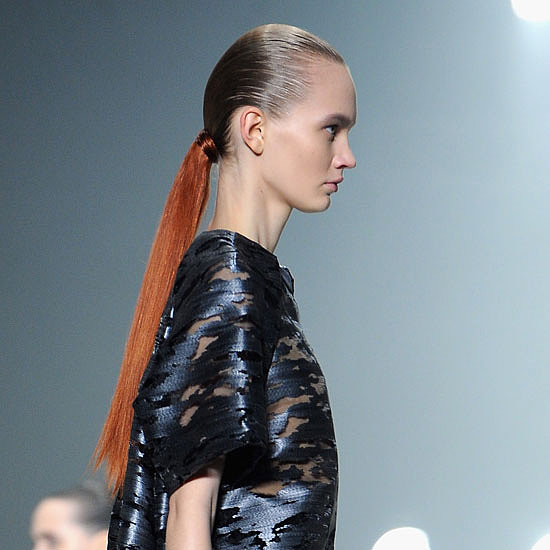 The hair pieces that were to adorn the models' hair were dyed to match model Irina Kravchenko's fiery red locks.
