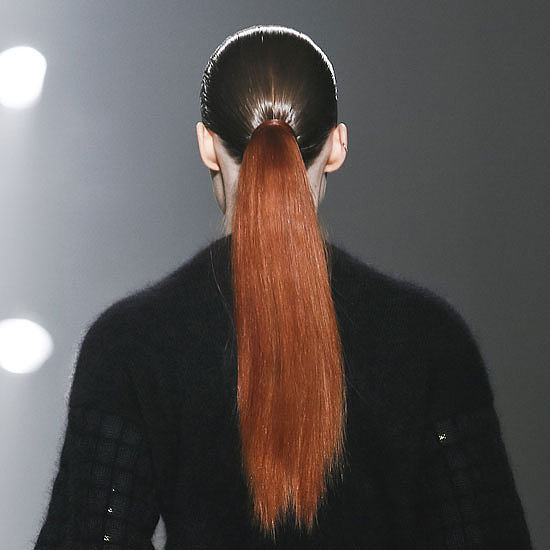 """The ponytail is simple and dramatic,"" Guido said. ""There's no reference to any period, but it is slightly futuristic."" The swatch of whiskey-tinted hair added to the surrealism of the look."