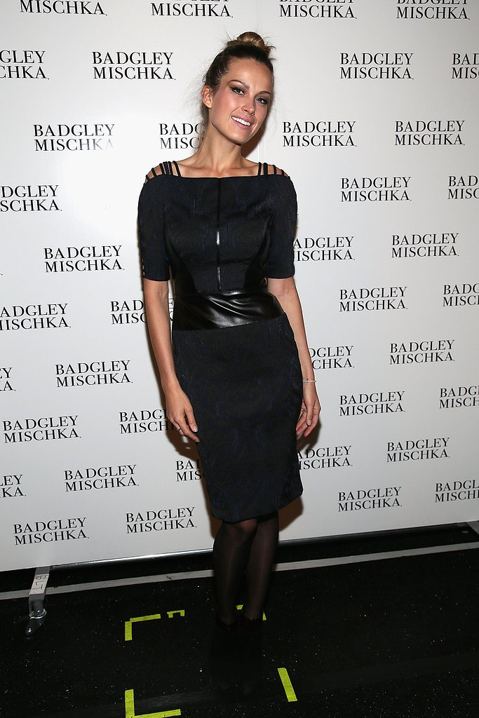 Petra Nemcova posed before the Badgley Mischka show in a printed navy-and-black sheath, complete with leather paneling.