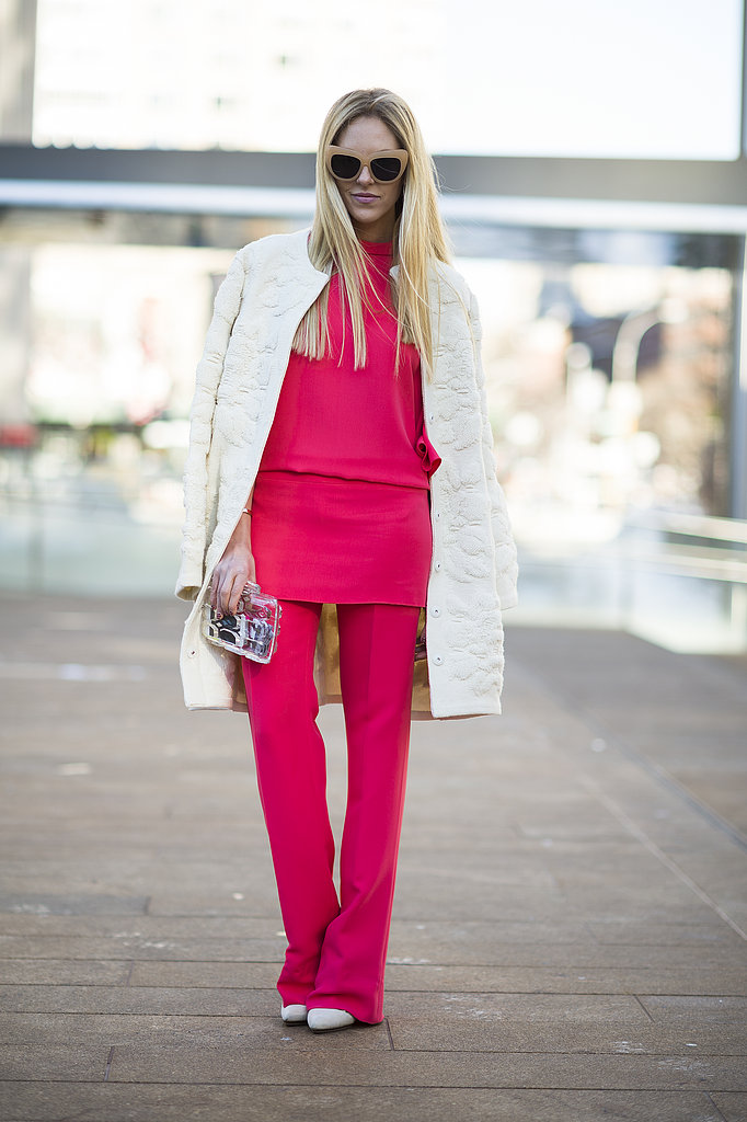 Gorgeous raspberry hues on her top and pants made a striking contrast against a crisp white coat.