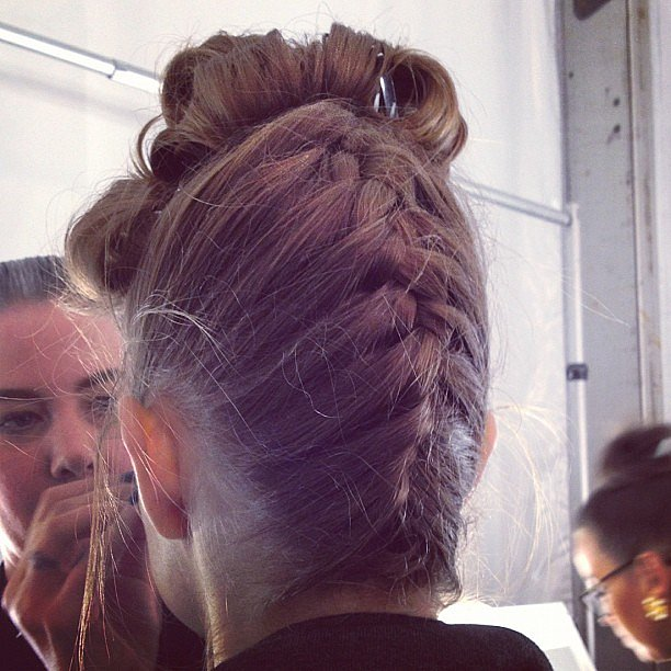 At Badgley Mischka, braided up 'dos were inspired by Hitchcockian beauties.