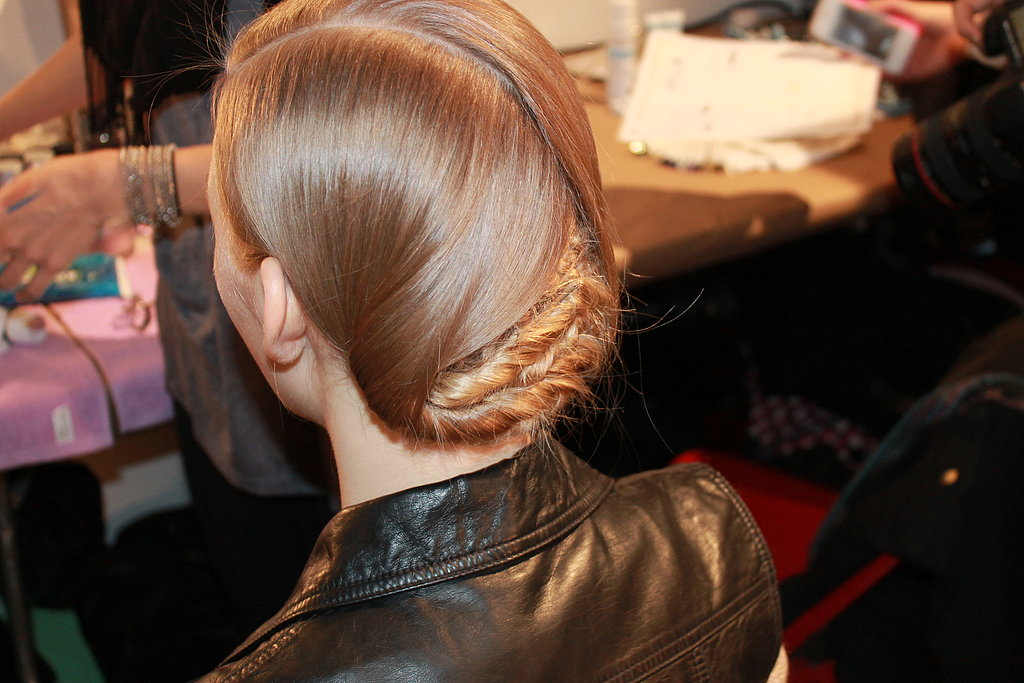 """Pecis described the back as """"probably being more complicated than it has to be."""" He started by spraying the hair with a volumizing spray before splitting it into three horizontal sections. He then plaited the bottom sections into cornrows and twisted the two side sections before folding them over for a """"curtain-like effect."""""""