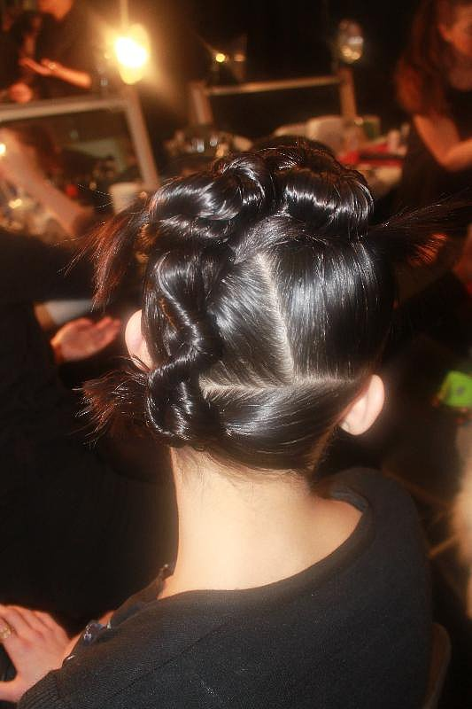 """The second style was a twisted and twirled updo with straight, sharp partings. If you want to get a perfect part every time, remember Pecis's tip: """"Put a little water on the hair, and brush through with the teeth. Watch where the hair starts to split, and from there use the tail comb to help refine it."""""""